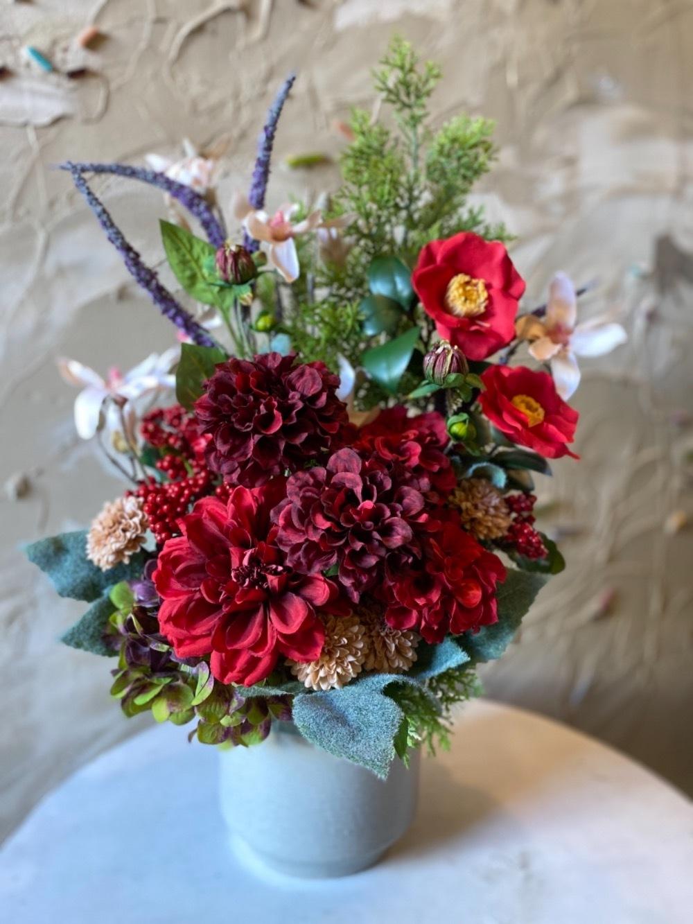 「このお花が目に映りいつも皆さまが和やかでありますように」造花の新築お祝い花