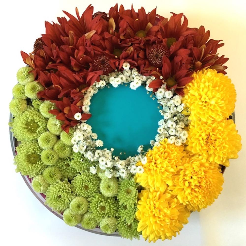 IT企業さまに贈られたサービスロゴフラワー祝い花