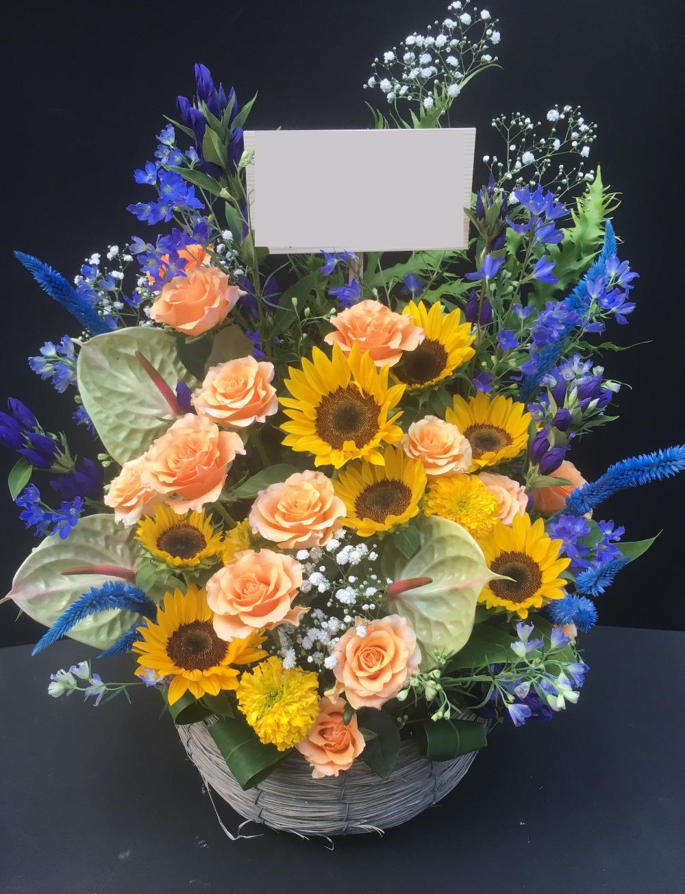 黄色とブルーが印象的なご就任祝い花