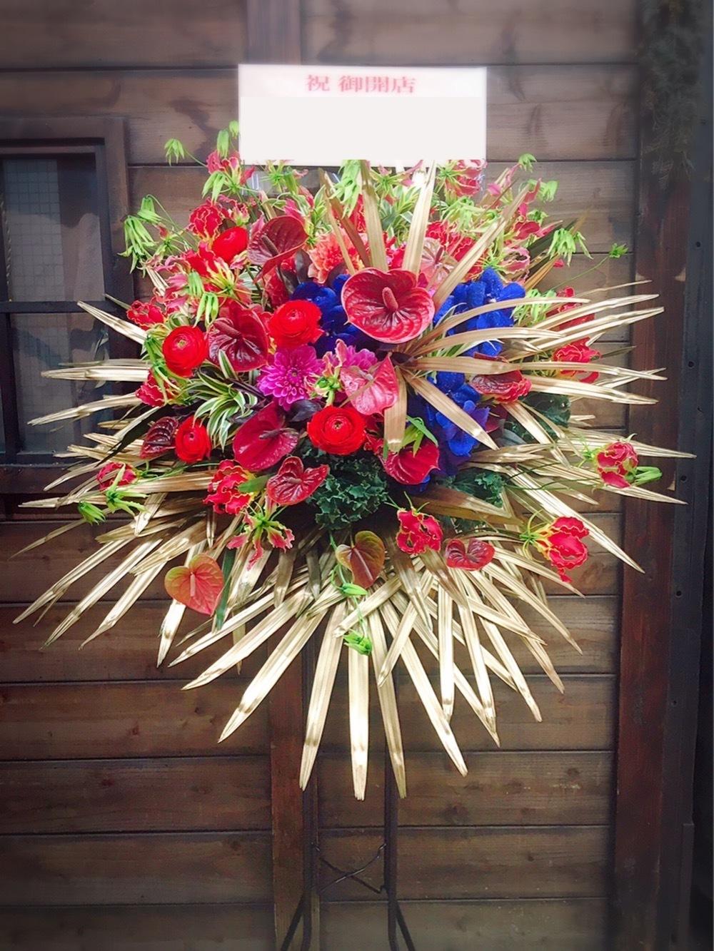 「お届け先さまのイメージで」赤の美しい開店祝いスタンド花