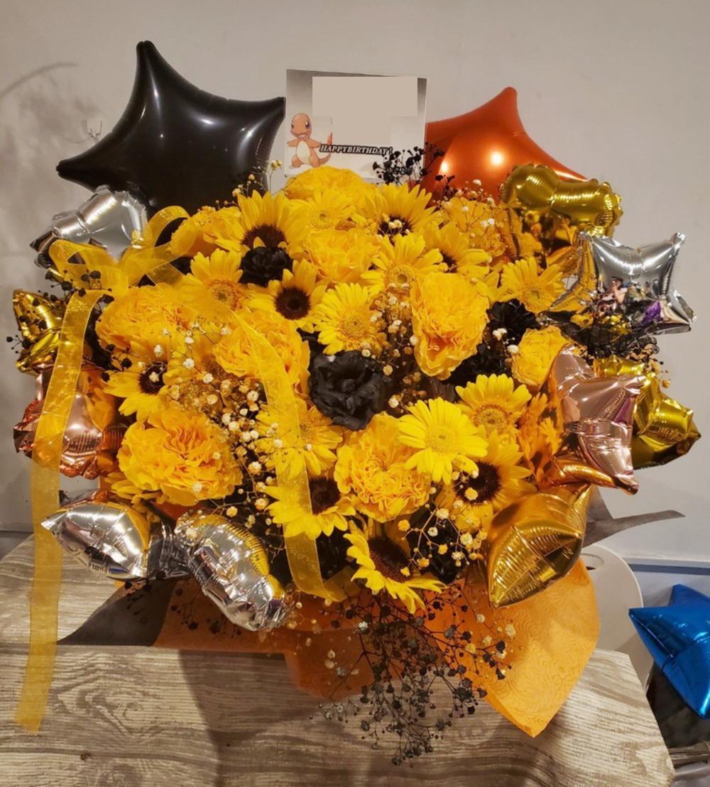 「素敵なお誕生日になるように」オレンジ色を基調とした誕生日お祝い花
