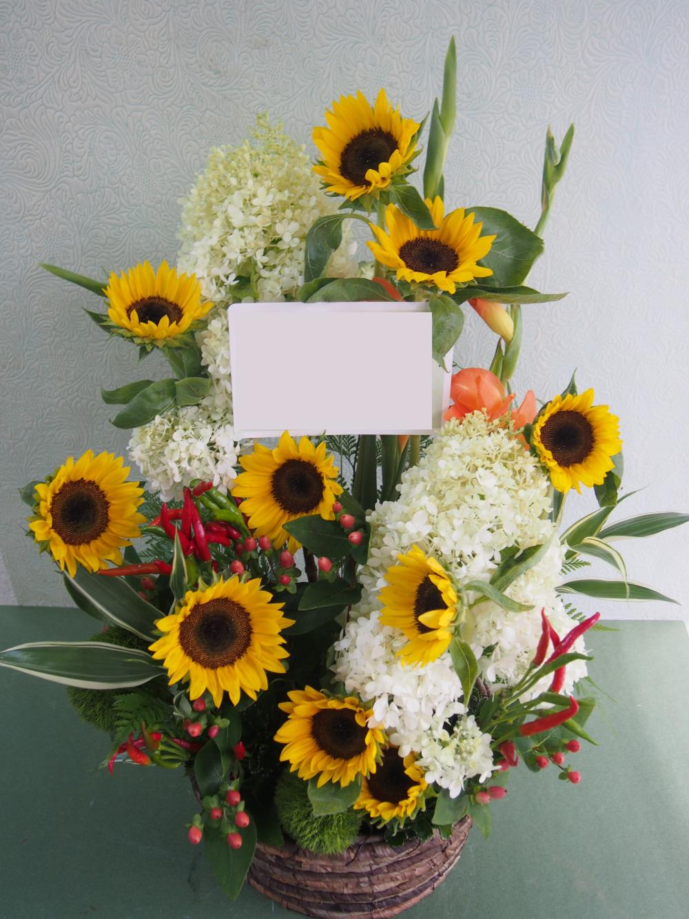 黄色を基調としたご開業お祝い花