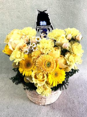 黄色が色鮮やかな周年祝い花
