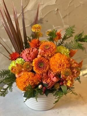 「更なる活躍を願って」初個展祝い花