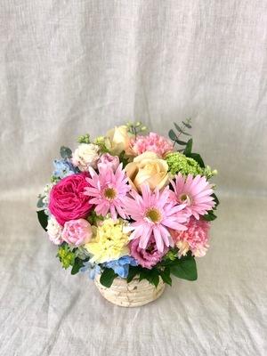 「お疲れ様とエールの想いを込めて」春色の退職お祝い花