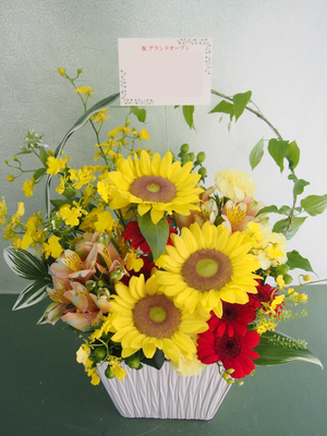 イメージカラーに合わせたグランドオープンお祝い花